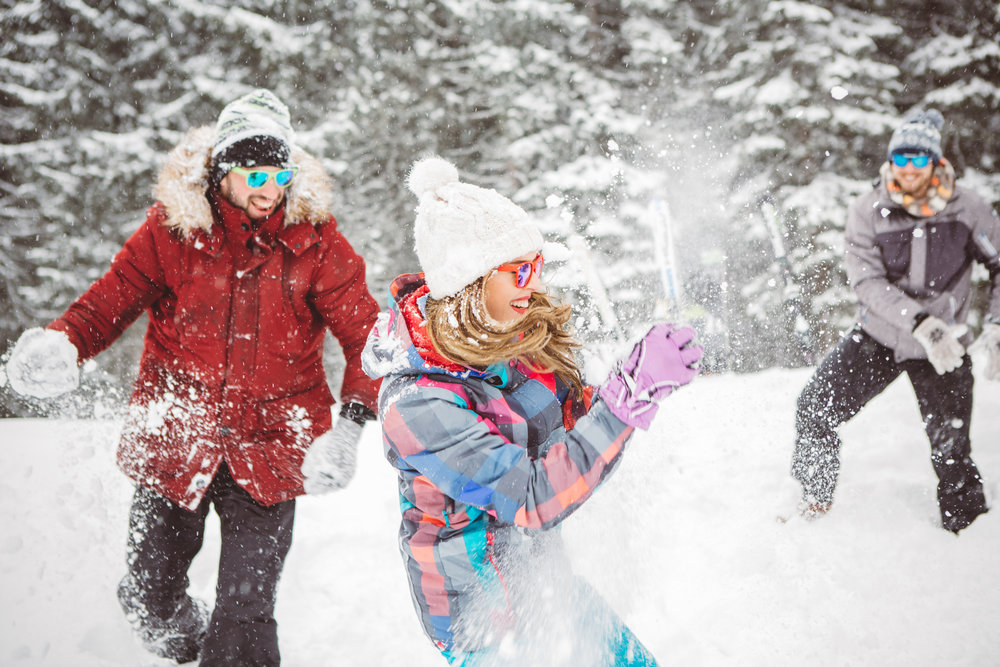 three people playing with snow at yosemite weather