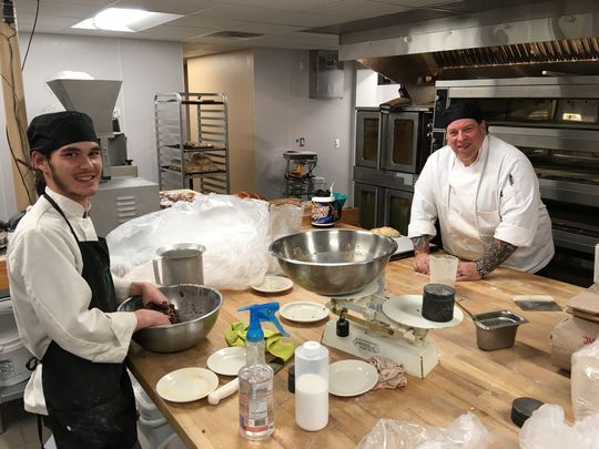 Bakers Caiden Carter, left, and Bob McCullock work on tomorrow's loaves in the Cornerstone's dramatically expanded bakery kitchen. The pair hold two of the 26 new jobs created when the cafe moved to its larger location. (Photo: Dave Tomlin/Ruidoso News)