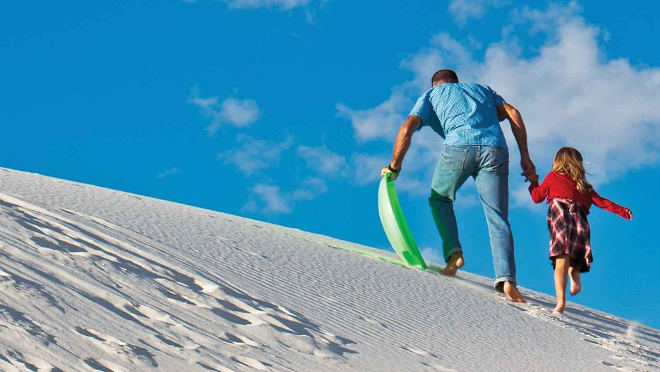 Do you want to get out and explore? At White Sands National Monument there are many activities to choose from including sledding and hiking.