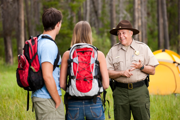 A ranger advises visitors about wildfire and campfire safety.