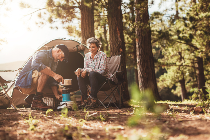 Making coffee in the wilderness using a camp stove.