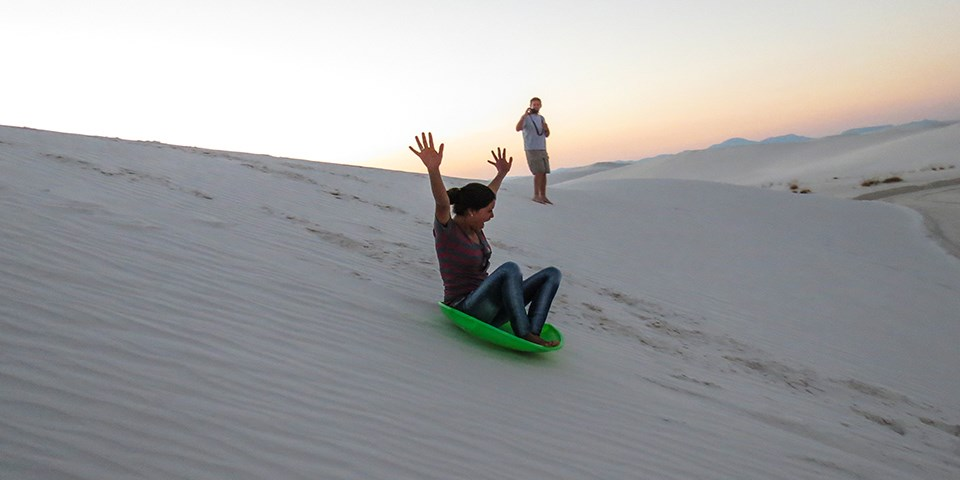 An experience that cannot be matched is sledding down the sand dunes.   NPS Photo