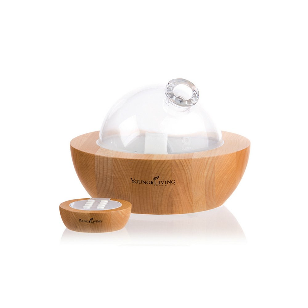 ARIA ULTRASONIC DIFFUSER    This diffuser is a treat to have in your home! The remote lets you choose from a selection of soothing, built-in sounds, run time, or enjoy the multicolored LED lights. With the built-in speakers, you can plug in your own personal music device and enjoy the music of your choice. Comes with a 5ml bottle of Tangerine and Peppermint essential oils.   Click here   to learn more about this product.