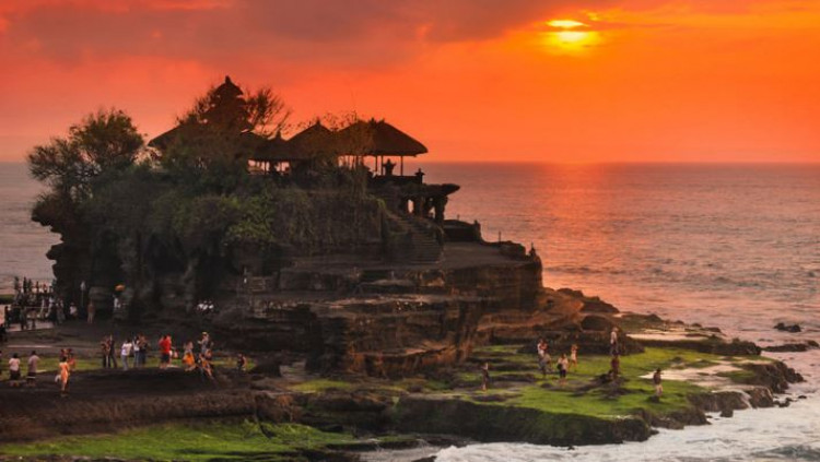 Tanah Lot - IDR 500,000++ per person mineral water supplied.There is no question about it that Tanah Lot Temple, located in Tabanan regency, is one of the best destinations and a must-visit attraction in Bali.The Tanah Lot temple was built and has been a part of Balinese mythology for centuries. The temple is one of seven sea temples around the Balinese coast. Each of the sea temples was established within eyesight of the next to form a chain along the south-western coast.In addition to Balinese mythology, the temple was significantly influenced by Hinduism. See the Tanah Lot sunset on the Tanah Lot Temple sunset temple tour.