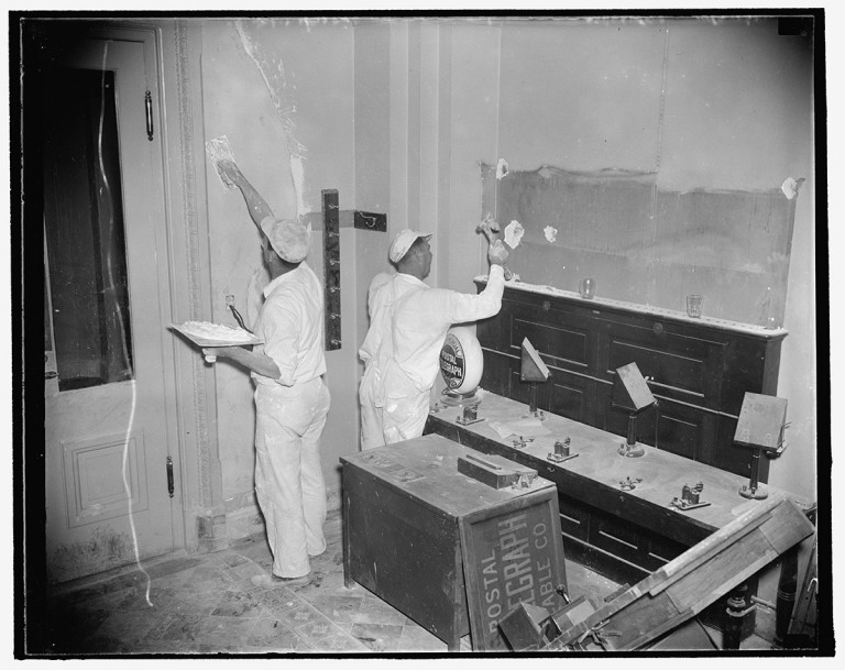 "New finish for Capitol press gallery. Washington, D.C., Sept. 28. Newspapermen will hardly recognize the house press gallery when they resume ""covering"" the Hill the next session. Taking advantage of the silent typewriters and telegraphic instruments workmen are busy re-plastering and painting the gallery from top to bottom, 9/28/37.  Photo by Harris & Ewing, 1937 September 28. hdl.loc.gov/loc.pnp/hec.23424"