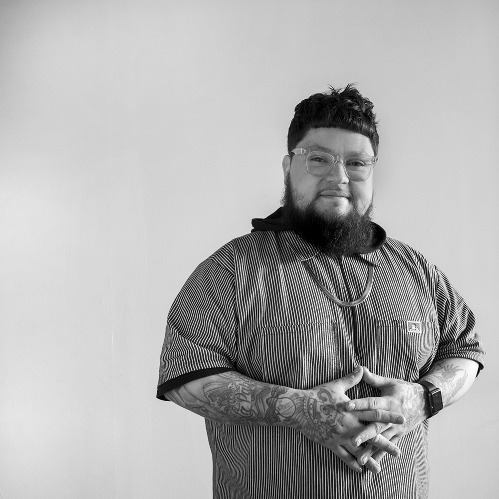 JOSHUA FLORES  Joshua is a barber with two years of professional experience. Joshua specializes in creating classic scissor cuts, clean fades, chiseled beardsandrazor sharp lines.