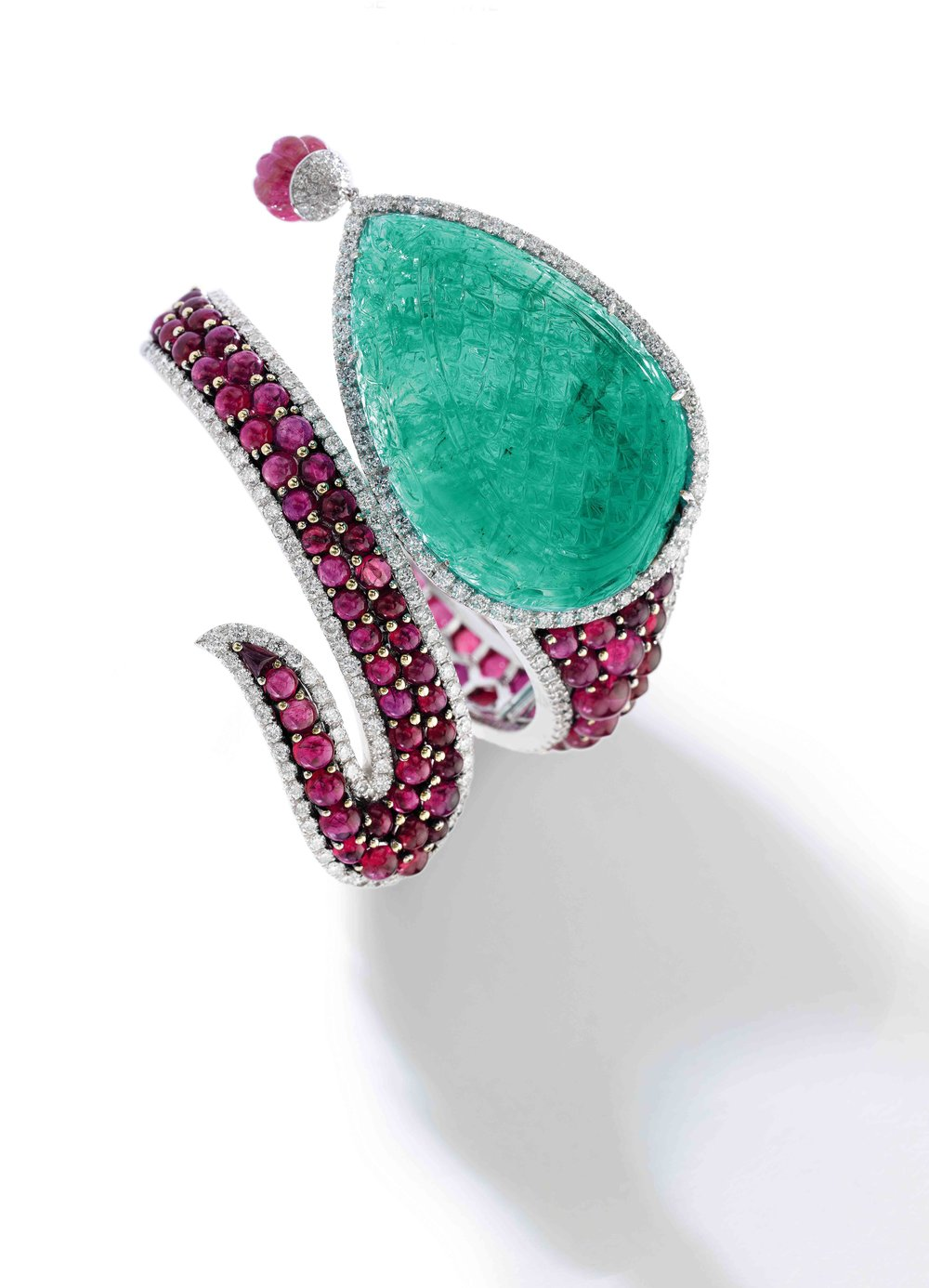 Emerald, ruby and diamond bracelet Featuring a drop-shaped carved emerald and pavé-set with cabochon rubies within a frame of brilliant-cut diamonds