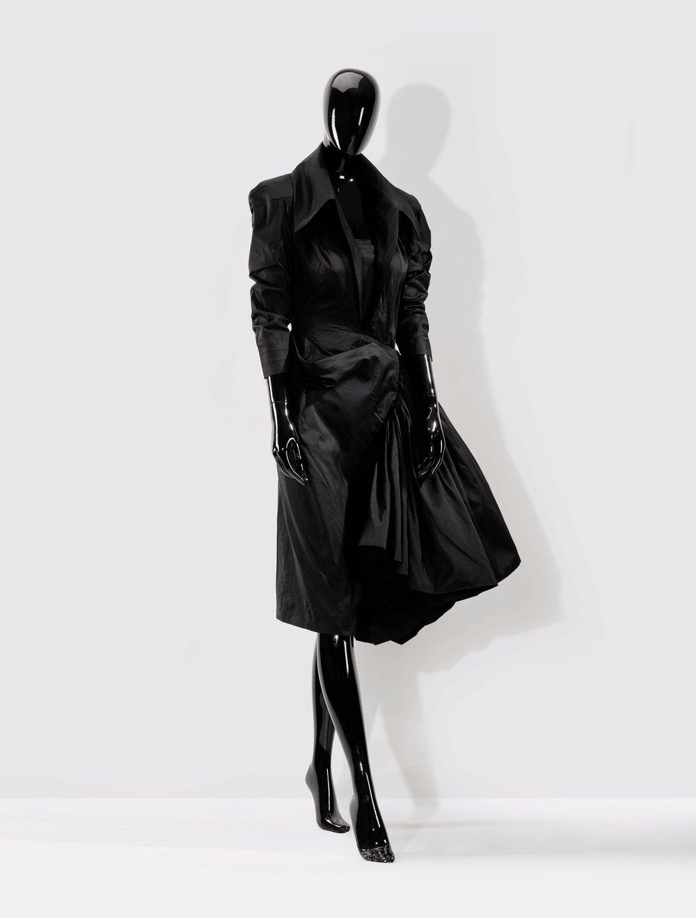 Christian Dior - 1950  A pin-taffeta gown  Estimate: €2,000-3,000
