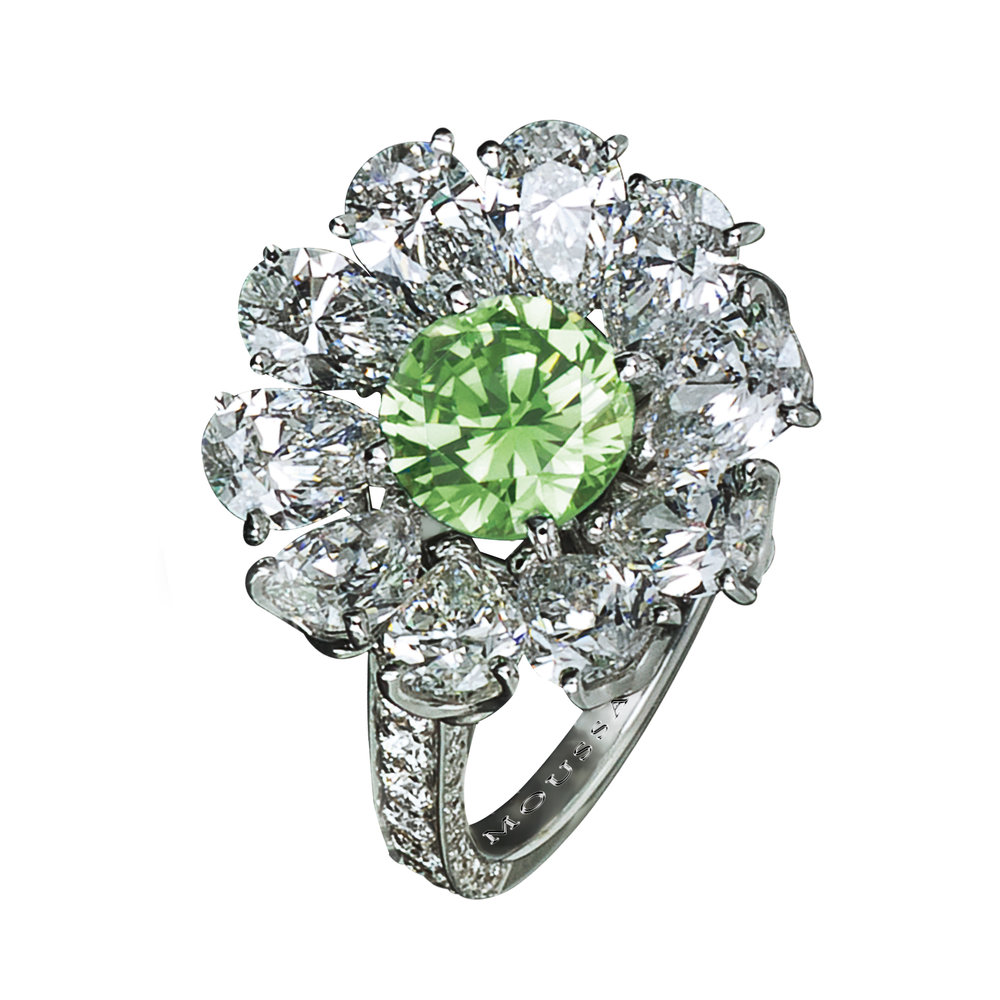 1.17ct Natural Fancy Vivid Green diamond and 3.84cts diamond ring, set in platinum.