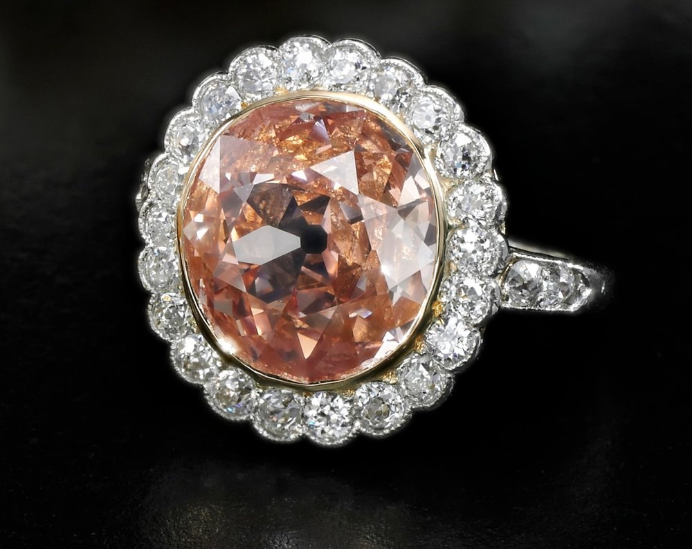 Impressive fancy orangy pink diamond ring - on black - Royal Jewels from the Bourbon Parma Family - Sotheby's 14 November 2018.jpg