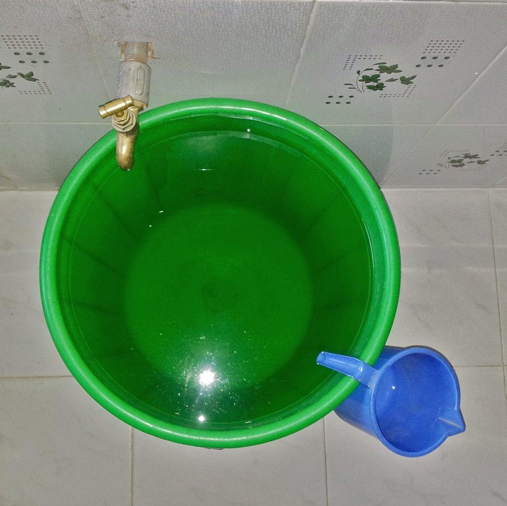 The bucket shower setup.