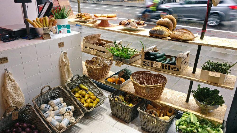Produce and breads in the shop's front window.
