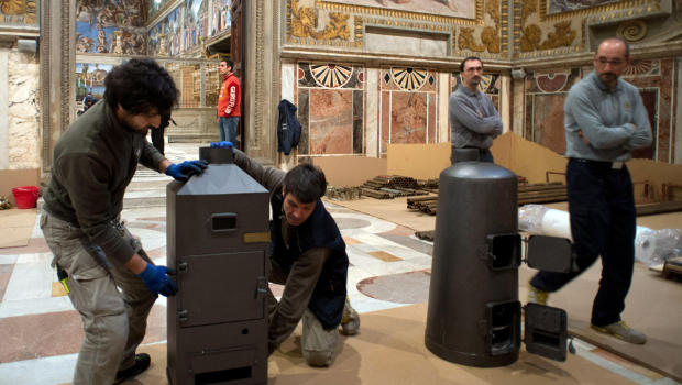 Preparing Conclave stoves in the Sala Regia, CBS News