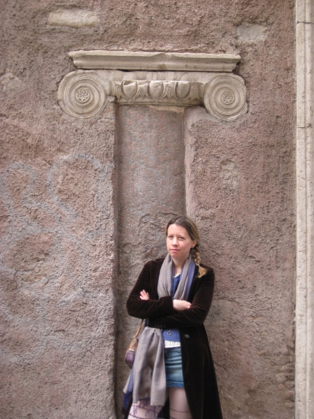 Your faithful correspondent some years ago, standing in front of an acient column incorporated into a building in Trastevere.