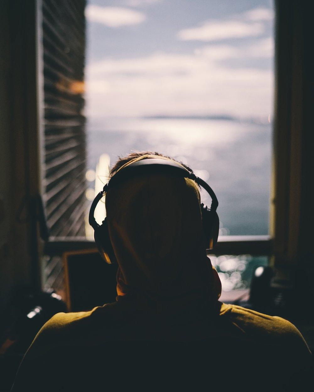 Man earphones looking out window © Reynier Carl.jpg
