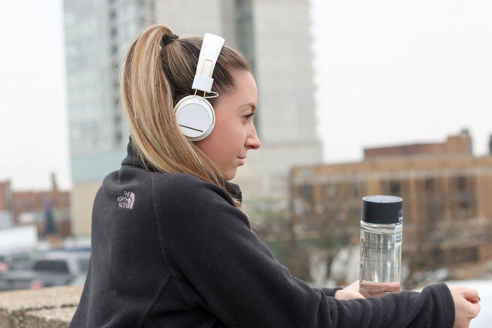 Girl with headphones in city.jpg