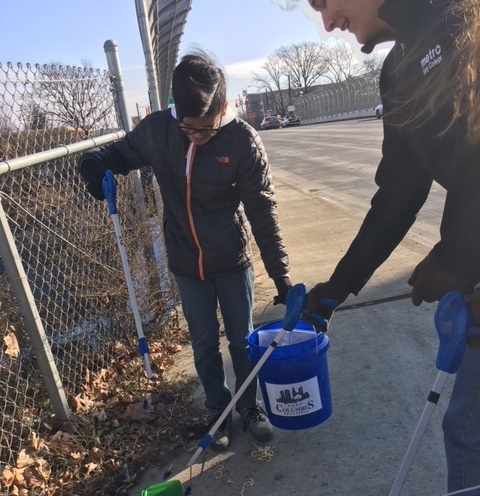 2 members assisting trash pickup for the Adopt-A-Highway Program