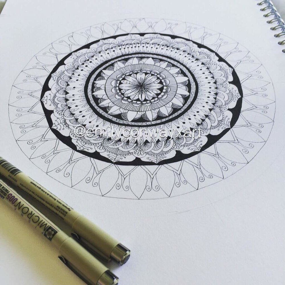 - I built the mandala up using different patterns and making some areas lighter than others and making the patterns as symmetrical as you can go around the circle. It helps to draw those reference lines in pencil first so that it is easier to keep the patterns as similar as you can.