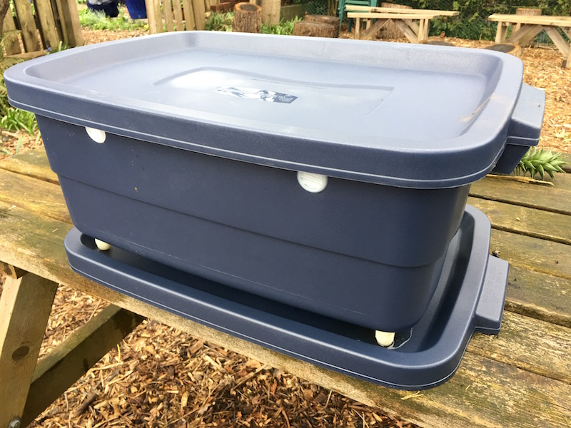Our new worm bin, with vents and feet, sits on a tray that collects worm 'tea', which is good for feeding your plants.