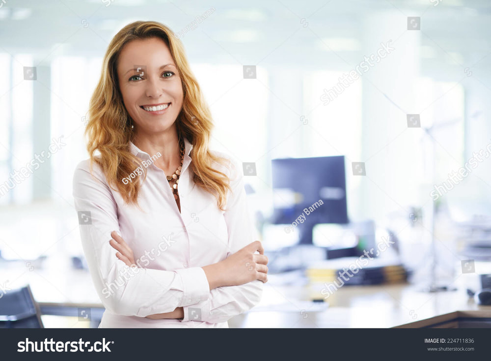stock-photo-attractive-business-woman-working-on-laptop-at-office-business-people-224711836.jpg