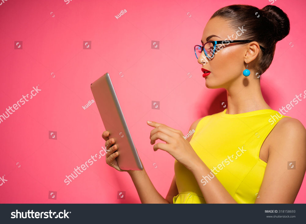 stock-photo-youth-and-technology-colorful-studio-portrait-of-young-attractive-brunette-woman-using-tablet-318158693.jpg