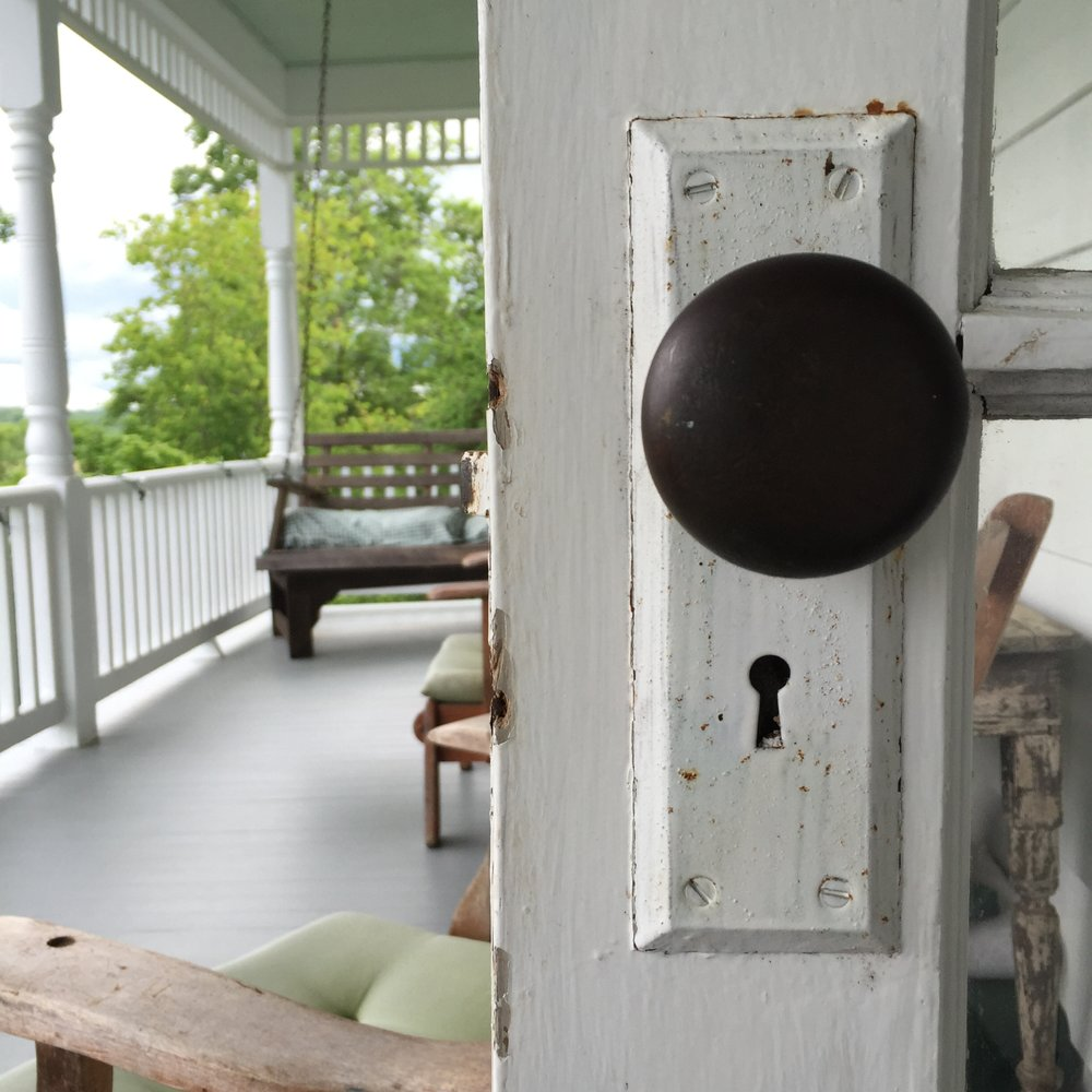 upper porch with doorknob.JPG