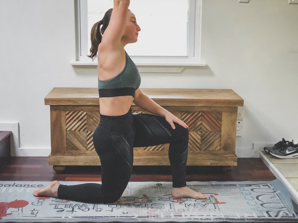 6. True Quad Stretch - This stretch is more intense but very effective in stretching the quads and the lower side of the body which can also contribute to back pain. Engage the glutei muscle while stretching one arm up and over slightly to the side to feel more stretch in the quad and the side of the hip and side body.