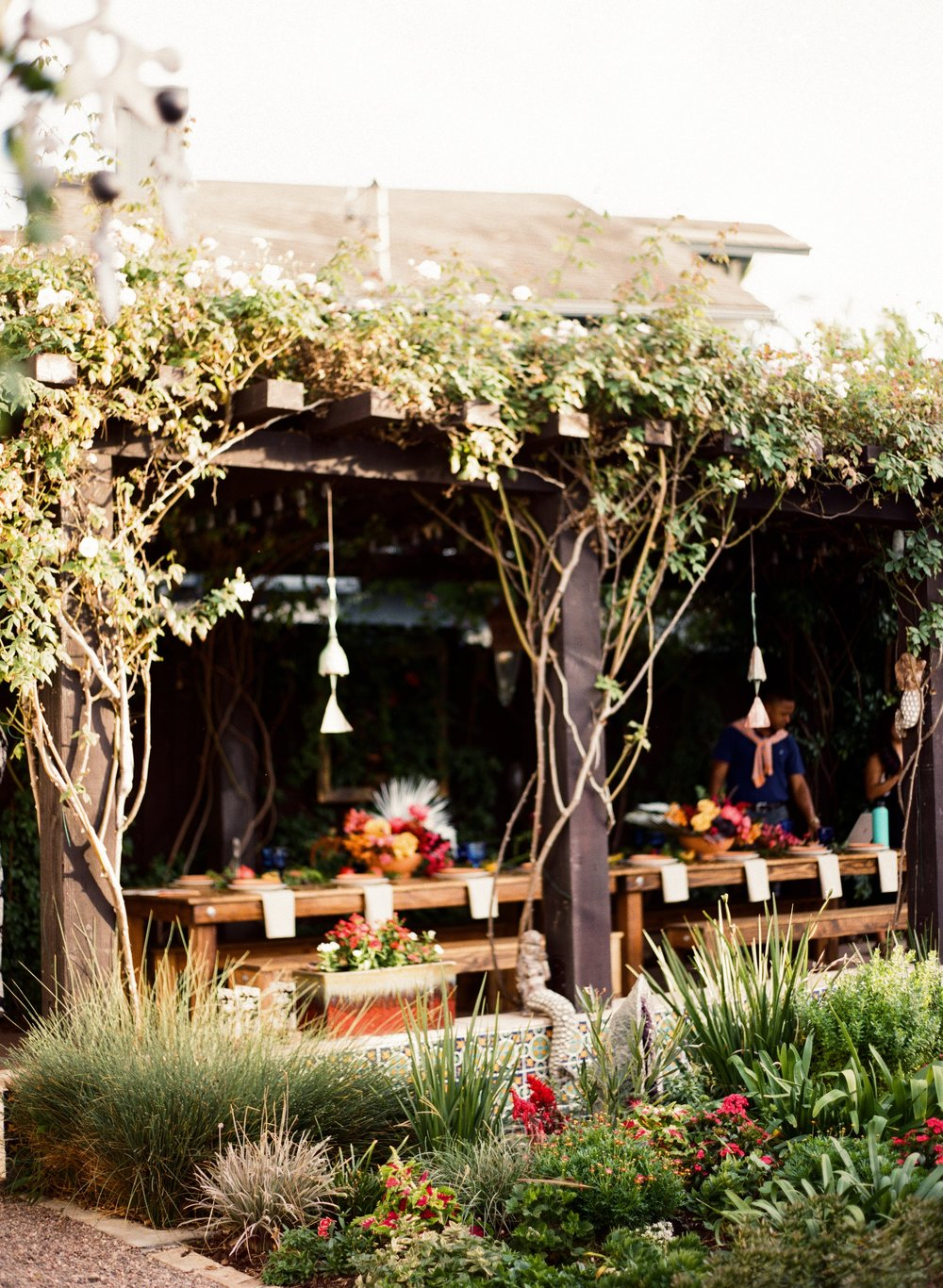 Sage Bleu Catering outdoor dining wood table tables cape with greenery and florals.