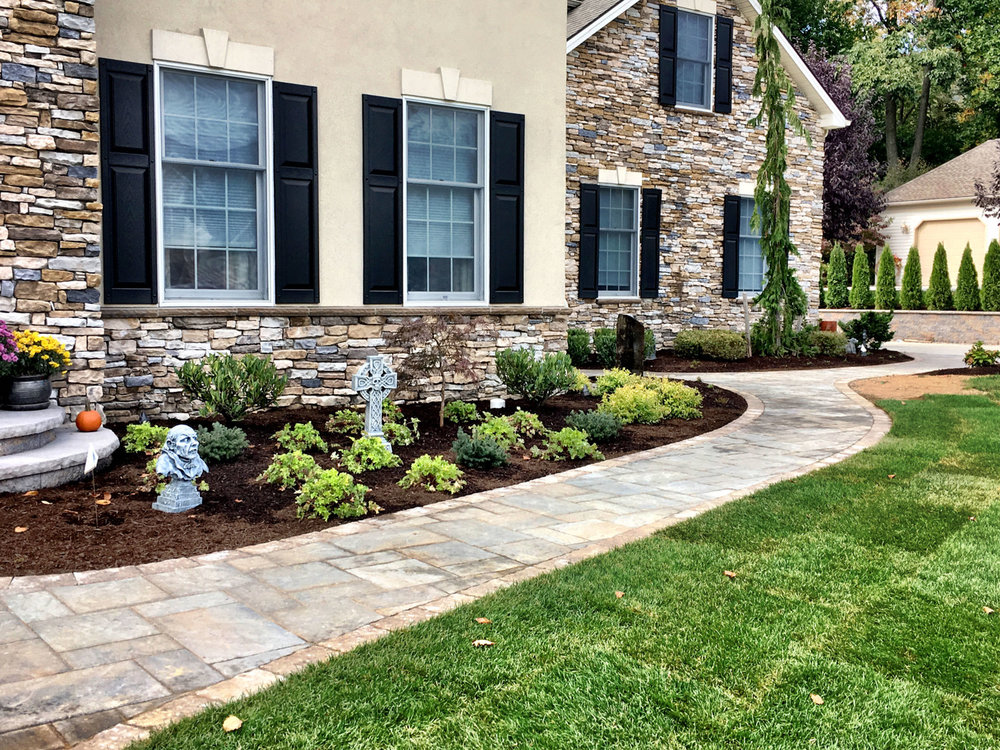Paver walkway and landscape design in Derry, PA by leading landscape designer