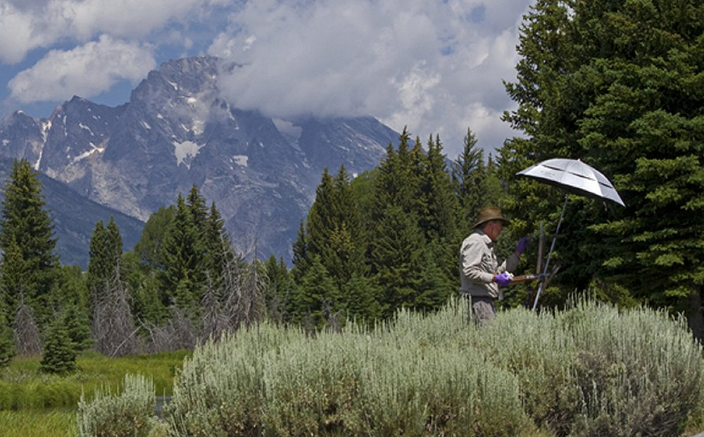 Artist Phil Wright of California hard at work below Mt. Moran