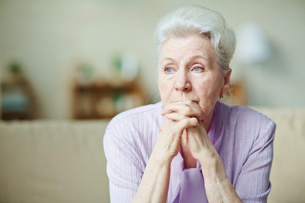 Elderly woman in a purple sweater