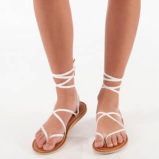 Leather Stitched Ribbon Sandals - Sseko Designs | $65 | Use stylemefair15 for 15% off!These are completely customizable! You can purchase straps of various colors and textures, and tie them multiple ways to create unique looks with the same pair of sandals. (Pictured are the white spaghetti straps). These are also extremely comfortable!