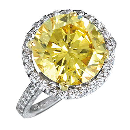 R12276 - White gold ring with Internally Flawless, Natural Fancy Vivid Yellow round brilliant cut diamond (4.97cts), with (0.77cts) of diamonds..jpg