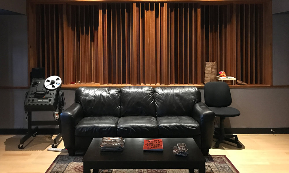 Control room diffusers with mandatory black leather couch