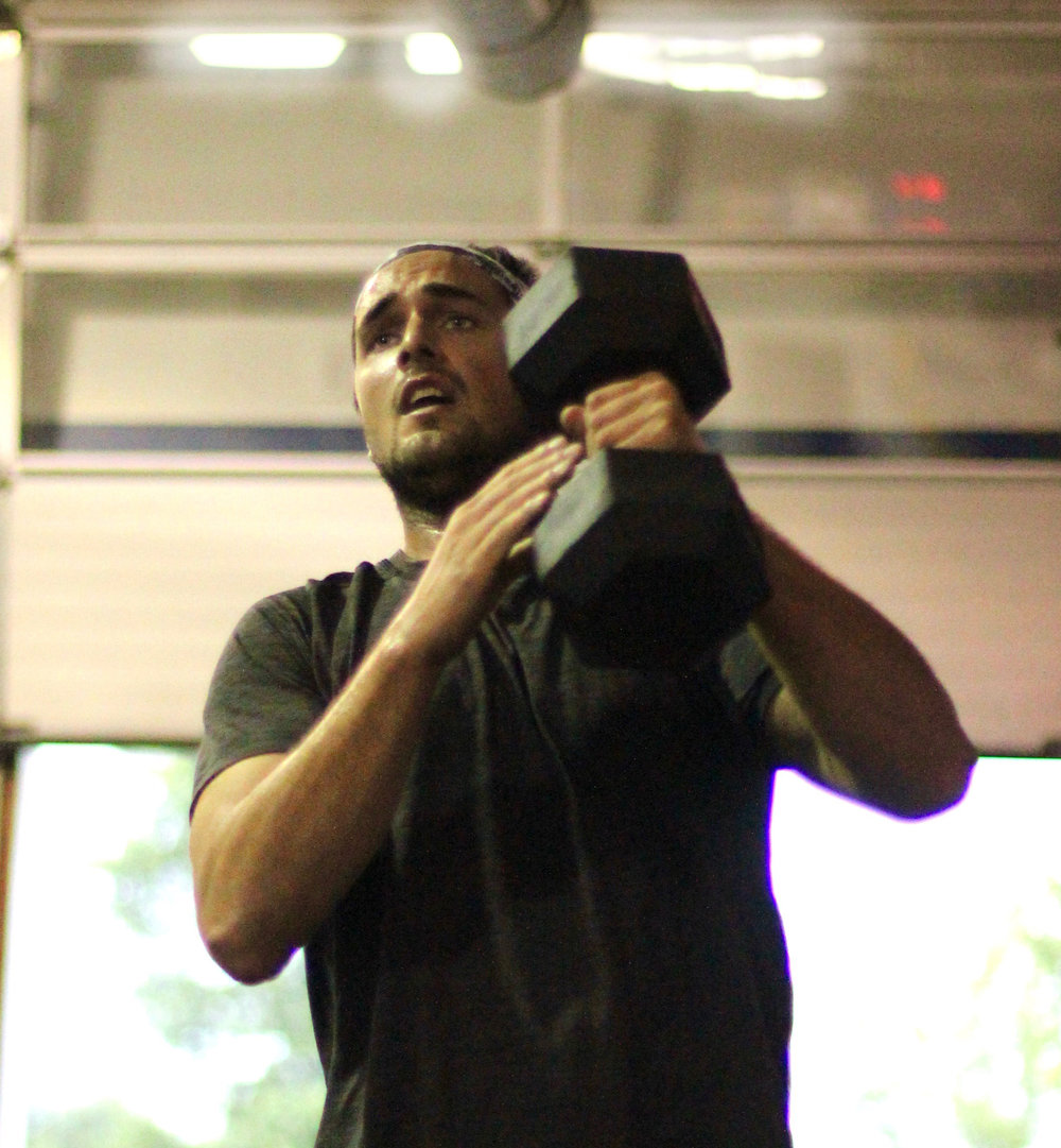 PVCF athlete, AJ practices the hand switch in between dumbbell snatches while keeping his eyes on the clock.