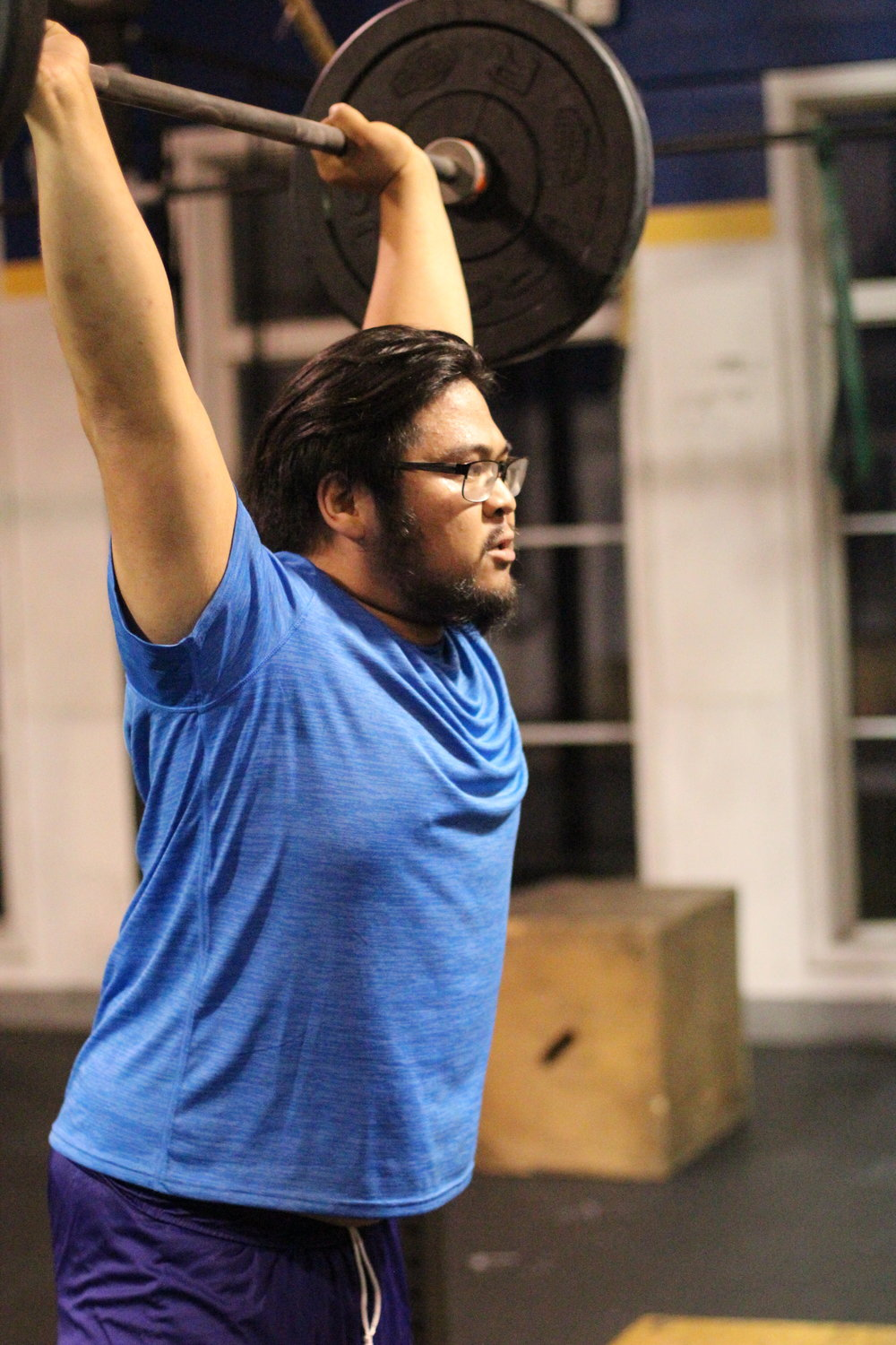 Barbells from ground to overhead? No problem! Here's PVCF athlete Bueno determined and triumphant in this clean and jerk!