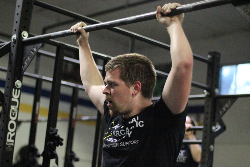 PVCF athlete, Nicholas Whitman checks out the clock during a set of pull ups.