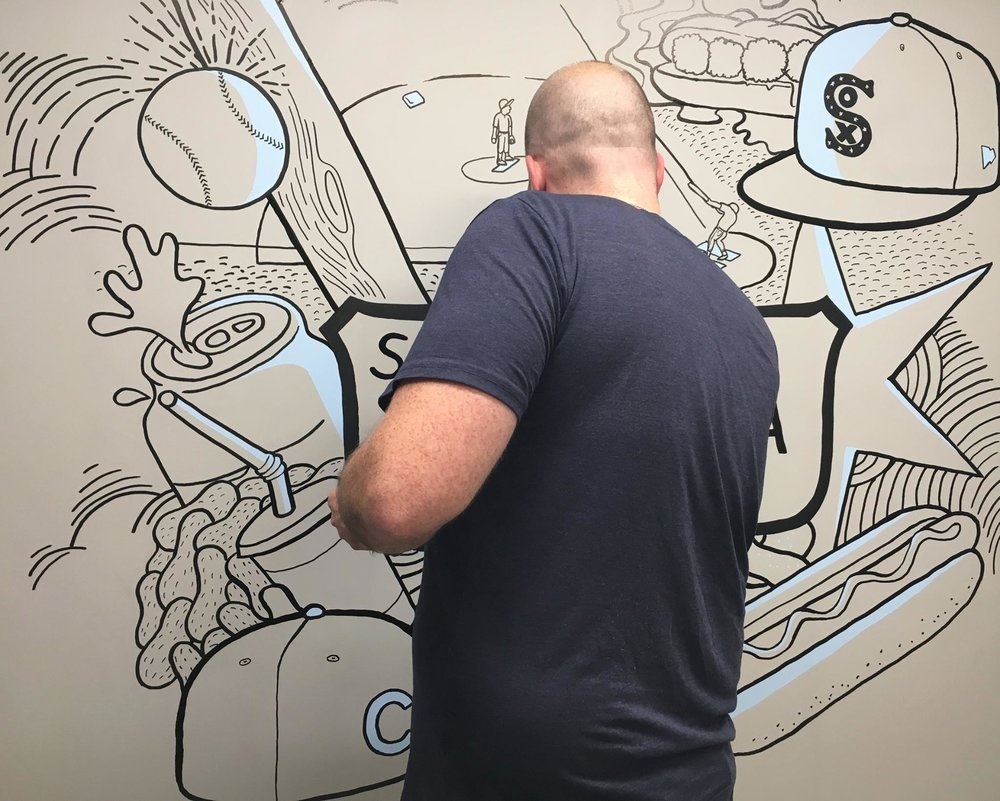 Hand painted mural by Jesse Hora