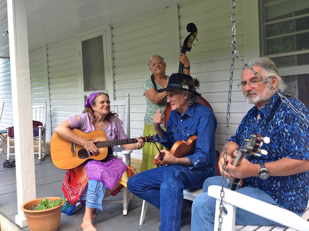 Day 17 closed with a performance of two old-time classics by T.V. Barnett and His Roan Mountain Moonshiners  (L to R, Rhodyjane Meadows, Sam Jones, T.V. Barnett and Michael Jones) on the porch of the 19th century Miller Homestead, inside Roan Mountain State Park.