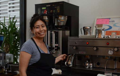 Alejandra, owner and operator of Un Cafecito 335 Jones Street