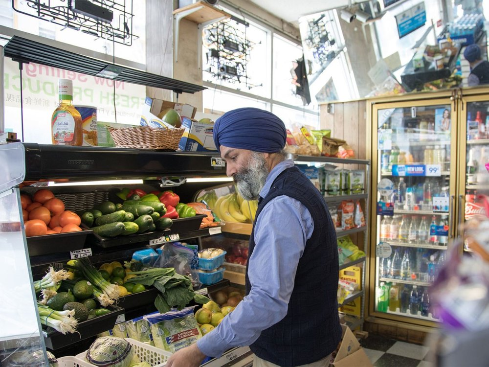 "Satwinder ""Bill"" Multani, owner of Daldas Groceries and Delicatessen in the Tenderloin, organizes the fresh produce in his store on Wednesday, May 10, 2017. (Steven Ho/Special to S.F. Examiner)"