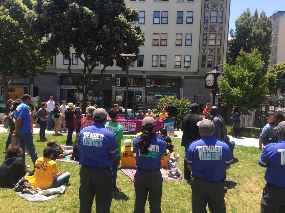 "TLCBD Clean Team members from Block by Block and Downtown Streets Team (DST) welcome DST to the Tenderloin with a ""Picnic in the Park"" launch event in July at Boeddeker Park."