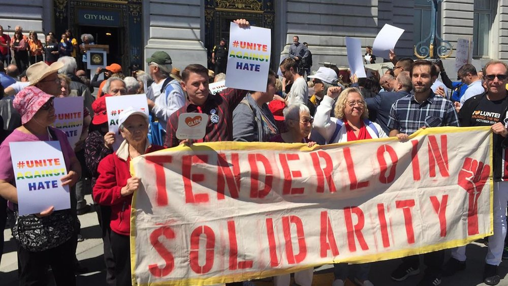 Tenderloin Solidarity Banner held by neighborhood residents and community organizers as part of the Unite Against Hate rally at City Hall on Friday, August 25th. Courtesy of  ABC 7 News