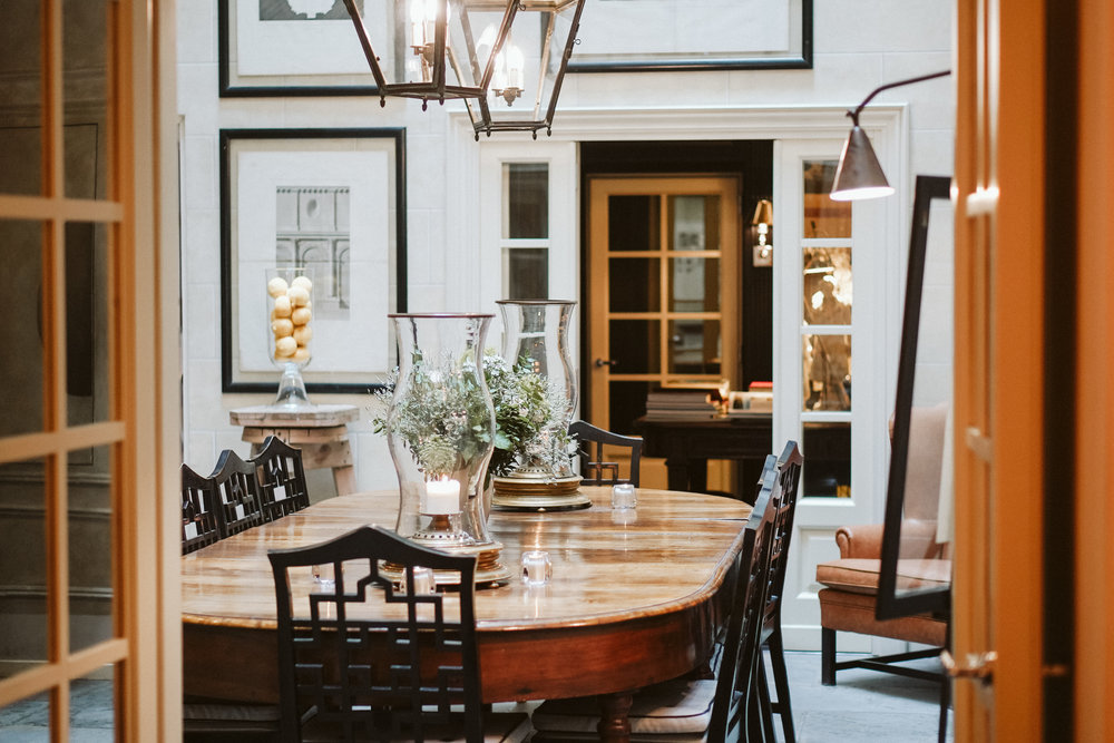 The breakfast room is paved with grey sandstone of the original building. A large unique walnut table and Latterns in copper are all from the 1800s. Chinese style chairs are designed by Michele Bonan.