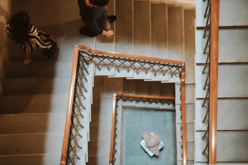 Grey sand stone is used for the wide, airy stairway in neoclassical taste.