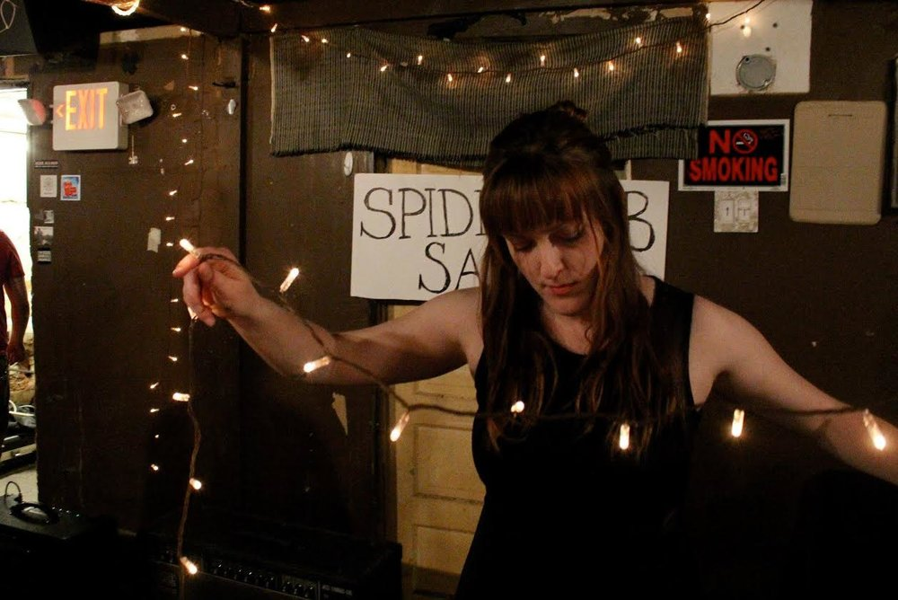 Bess Whitby setting up for spiderweb salon's first electronic experiment show | photo by courtney marie | 2014