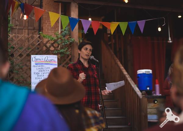 Logen reads at Spiderweb's Cheers for Queers event in 2018. Photo by Saraphim Art