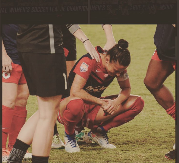 Ali Krieger comforted by teammates after 2016 NWSL Championship defeat. The game was decided by PKs PC: FARRIS PHOTOS