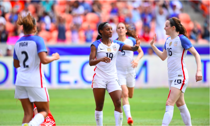 Crystal Dunn (center), celebrates with teammates Mallory Pugh (left) and Rose Lavelle (right) after scoring her second goal of the day against Russia PC: Brad Smith