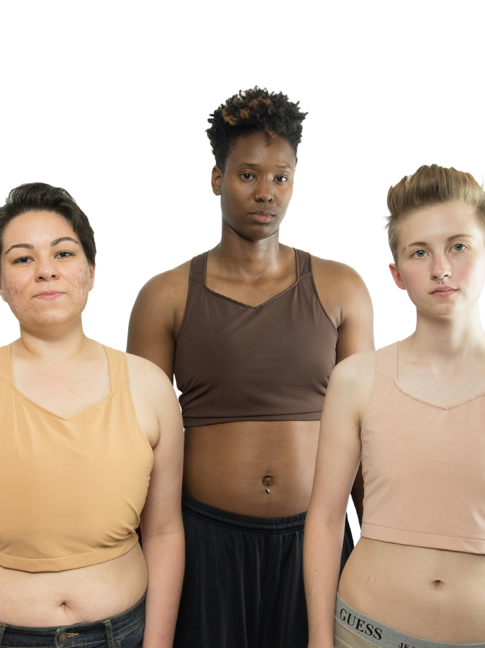"""FLAVNT Streetwear - FLAVNT Streetwear is a trans-owned brand that popped up a few years back in Austin, Texas. They sell LGBTQ+ shirts and merch, and have a line of Bareskin binders designed to match closely to a variety of skin tones. They have five colors now in a single cropped style, from a peachy """"Rose"""" (right) to a dark """"Umber"""" (center) all priced at $50.The material is soft and comfortable, and we've heard the straps don't cut into your shoulders like other brands might. Their fabric does make an audible crinkling sound when you move around, but it's still a fairly discreet binder. Plus, the material is safe for swimming.The only downside is that their sizing is limited in certain colors. When we searched earlier (late 2018/early 2019) there were no Rose available at all, and sizing was super limited in all colors except the two darkest."""